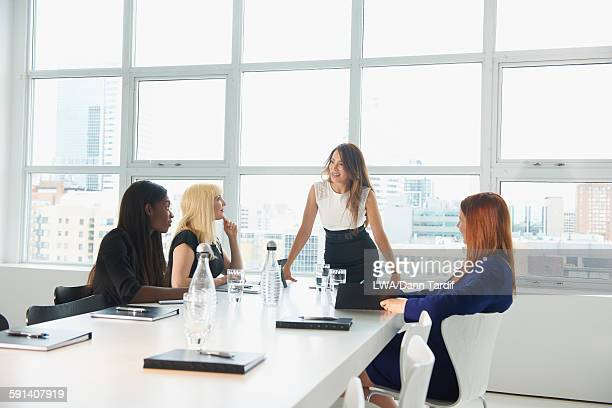 Businesswomen talking in office meeting