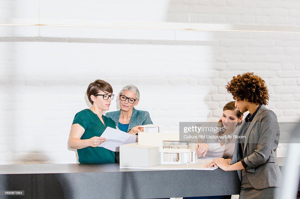 Businesswomen talking in office : Stock Photo