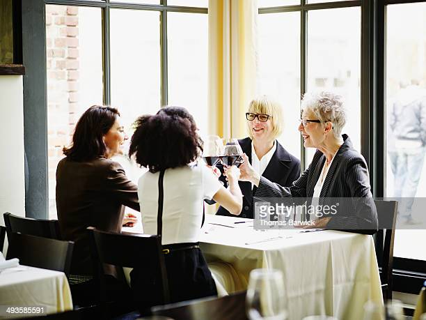 Businesswomen toasting during business meeting