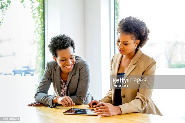 Businesswomen using digital tablet in office