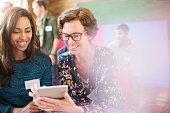 Businesswomen using digital tablet