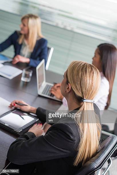 Businesswomen using laptop and digital tablet on a meeting