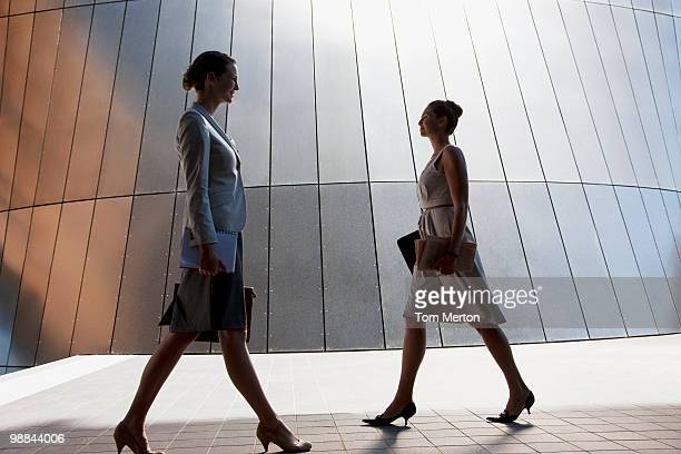 Businesswomen walking outdoors