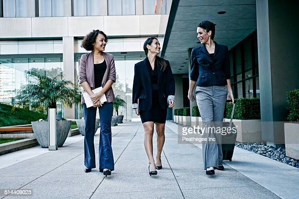 Businesswomen walking together outdoors