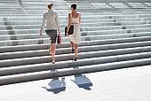 Businesswomen walking up steps outdoors