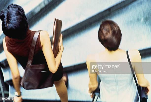 Businesswomen walking up steps, overhead view