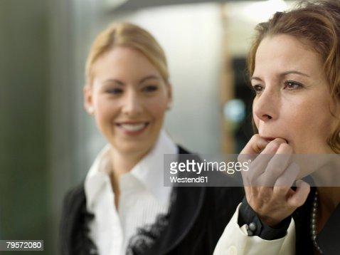 Businesswomen whistling on fingers