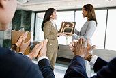 Businesswomen with award