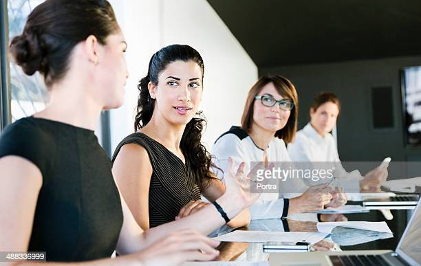 Businesswomen with laptops in conference room