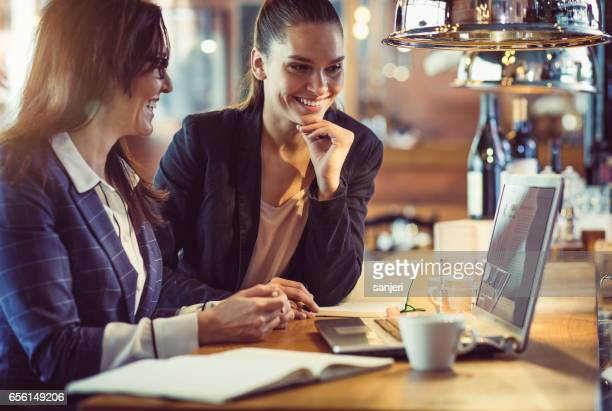Businesswomen Working at a Cafe Restaurant