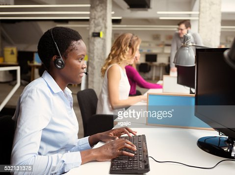 Businesswomen working at call center.