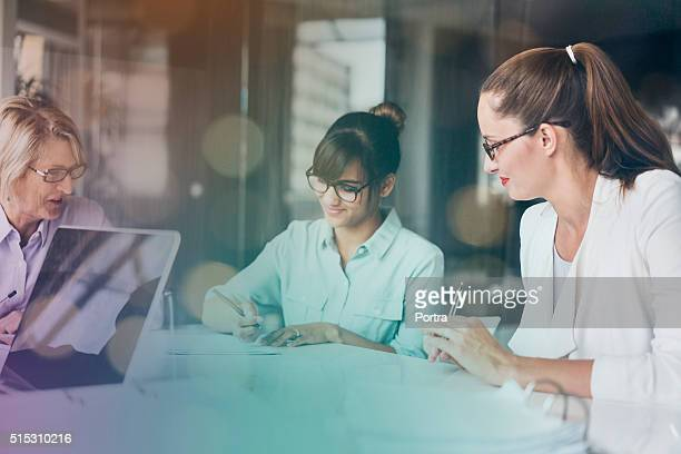 Businesswomen working at desk in office