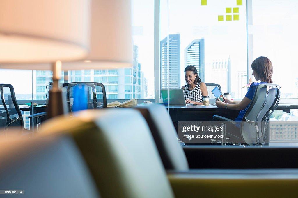 Businesswomen working at desk : Stock Photo