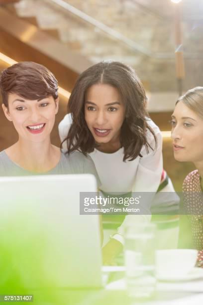 Businesswomen working at laptop in office