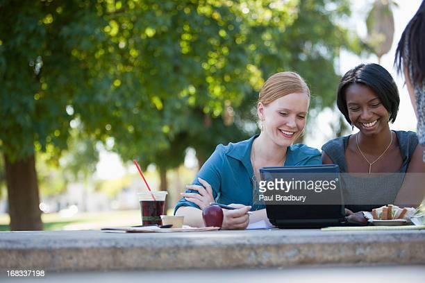 Businesswomen working in park