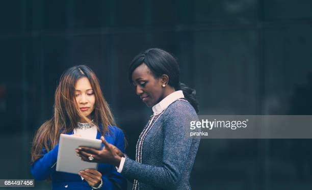 Businesswomen working outdoors