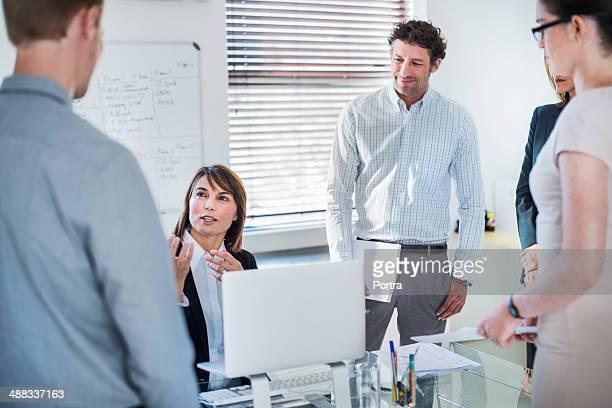 Busineswoman talking to her team