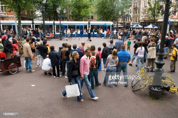 Busker and crowd at Leidseplein in Southern Canal belt.