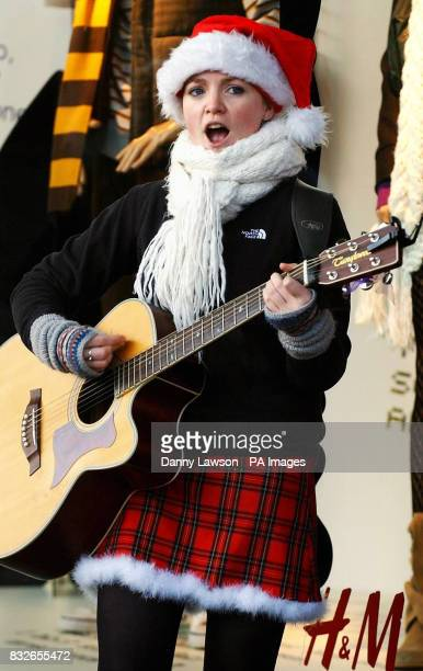 Busker Becky Robertson entertains Christmas shoppers on Princes Street in Edinburgh after a survey by theology think tank Theos found that the Spirit...