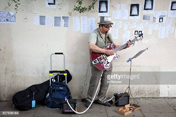 Busker on Portobello Road market Notting Hill West London This famous Sunday market is when the antique stalls come out as well as the food stalls
