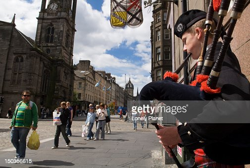 Busker playing bagpipes on Royal Mile.