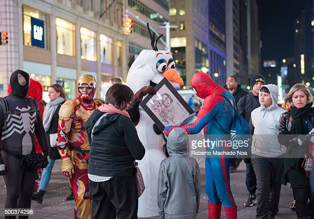 Buskers in Times Square at night in New York City Times Square is a major commercial intersection and neighborhood in Midtown ManhattanThe landmark...