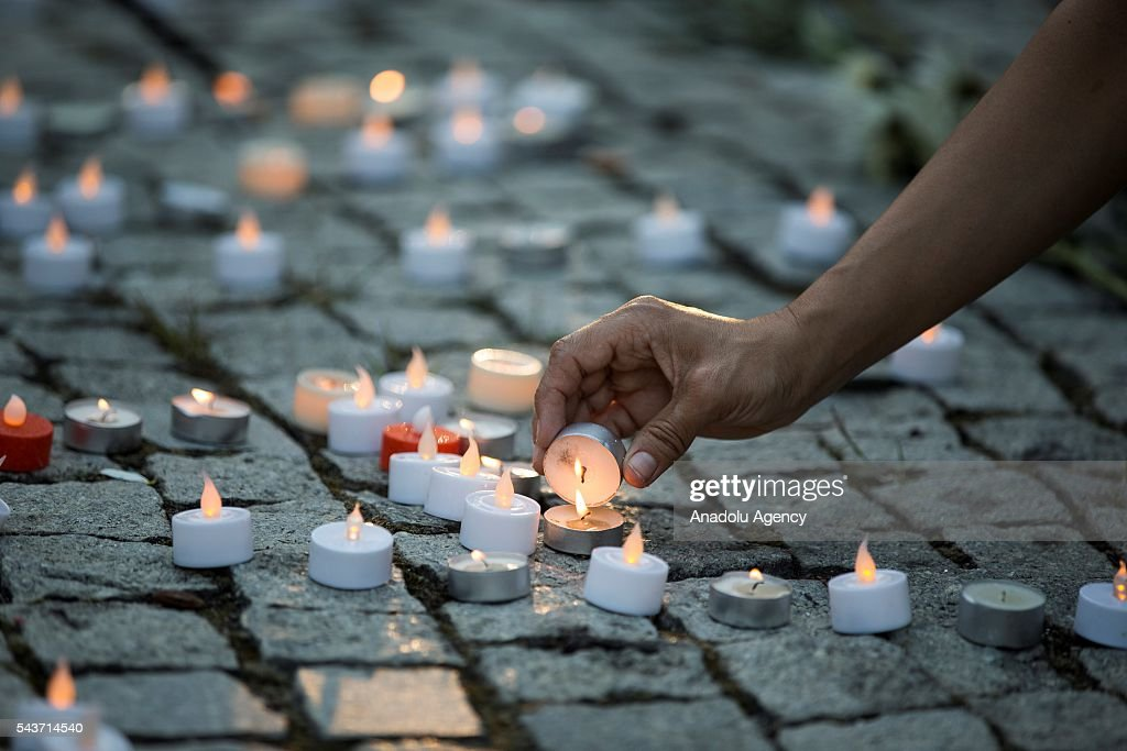 Busra Kayi Tarhan from Istanbul lights a candle in Dupont Circle during a vigil for the victims of the Istanbul Airport terrorist attack Washington, USA on June 29, 2016.