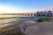 A stunning image of the Busselton Jetty taken at Sunset. Situated near the City of Perth, in Western Australia, it is the longest wooden jetty in the Southern Hemisphere, stretching almost 2km out to
