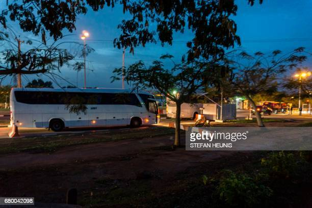Busses transporting some of the released Chibok girls arrive at the Presidential Villa in Abuja Nigeria on May 7 2016 Eightytwo of the more than 200...