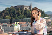 Business woman making calls, arranging meetings, making reservations, making business plans