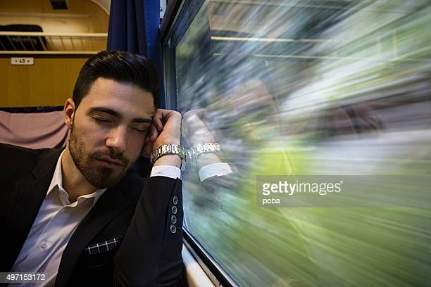 bussinesman  relaxing on the passenger train