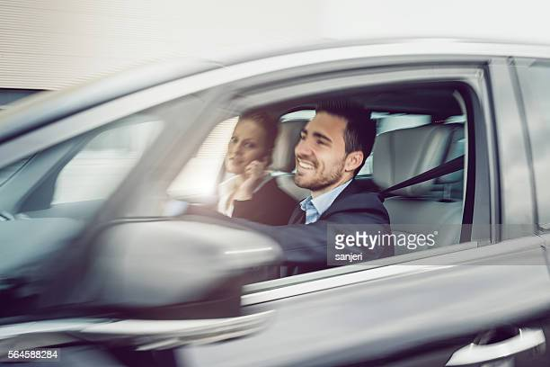 Bussiness Couple Making a Call in The Car