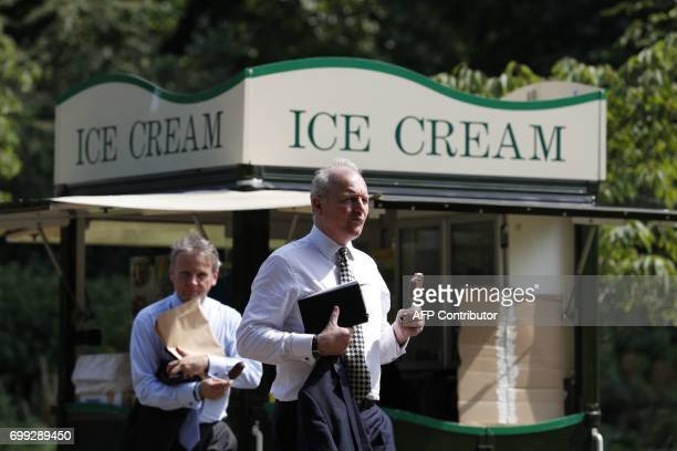 Bussinessmen buy ice cream in St James's Park in central London on June 21 2017 Europe sizzled under a continentwide heatwave on June 21 with London...