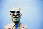 Bust of a man with eyeglasses