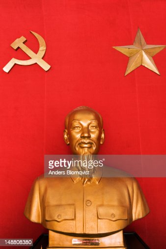 Bust of Ho Chi Minh by communist emblems of Vietnam in Army Museum on P Dien Bien Phu street. : Stock Photo