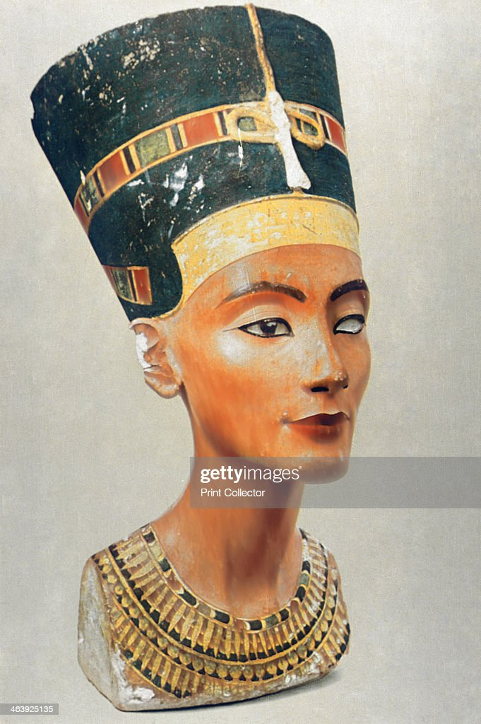 Bust of Nefertiti, queen and wife of the Ancient Egyptian Pharaoh Akhenaten (Amenhotep IV). Nefertiti reigned from 1353-1336 BC. She was a supporter of Akhenaten's worship of the sun god, Aten. From the Egyptian Museum Cairo. Located in the Museum of Cairo, Egypt.