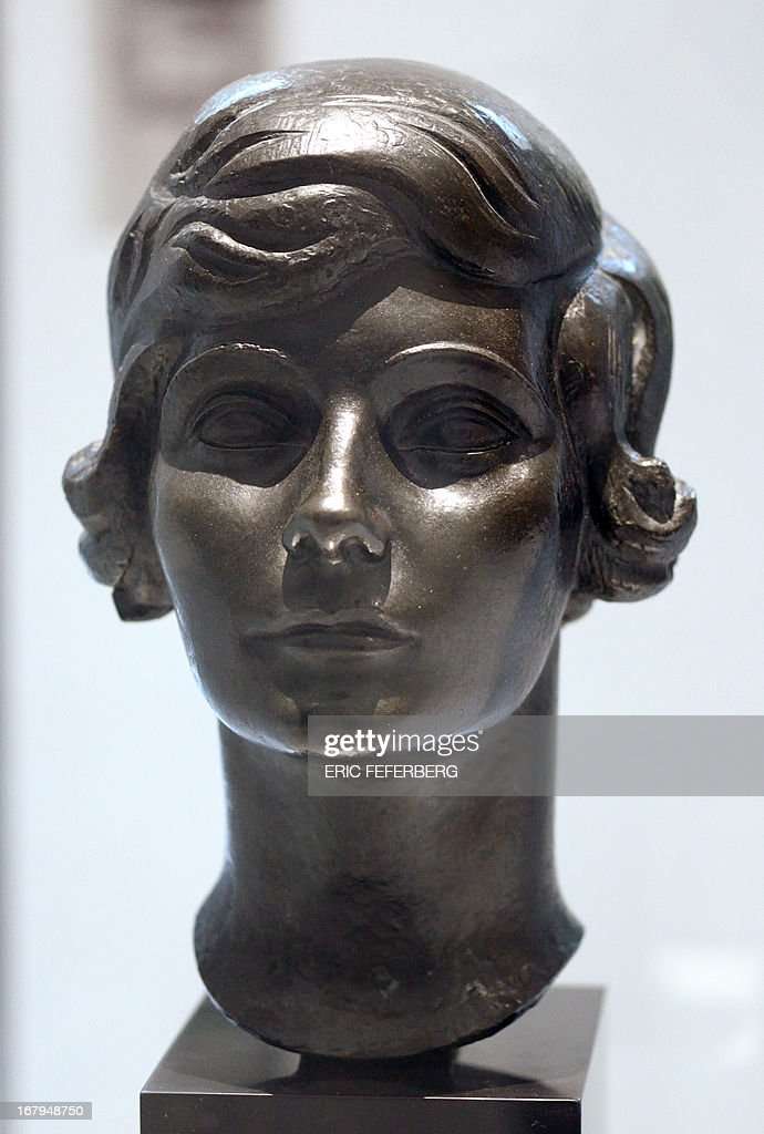 A bust representing Coco Chanel made by Jacques Lipchitz in 1921 is displayed as part of the exhibition 'N°5 culture Chanel' at the Palais de Tokyo in Paris on May 3, 2013. AFP PHOTO / ERIC FEFERBERG