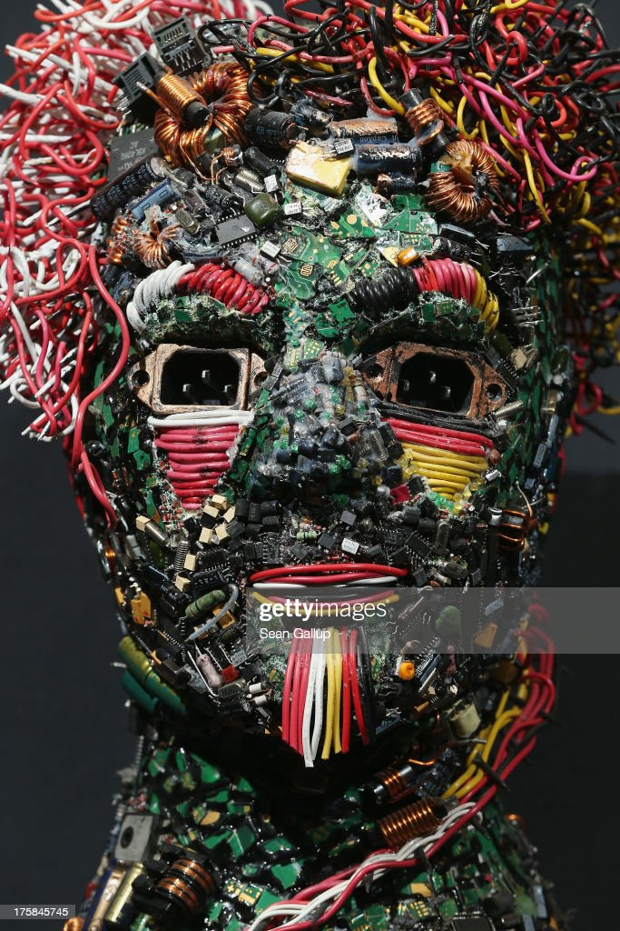 A bust, whose surface is completely covered in electronics junk and titled the 'The German-Turk' stands at the electronics repair shop owned by Muharrem Batman in Neukoelln disrict on August 8, 2013 in Berlin, Germany. Batman has created a wide variety of busts and even full body sculptures whose outer surfaces are nearly completely covered in electronics capacitors, resistors, bits of circuit boards, CPUs, wiring, keyboards and other scrap he has salvaged from old computers and other devices. Though he says the designs are his own, he admits his sister Ayse and colleague Judith Brun do the much of the actual work. 'I just don't have the patience for it, women can do something like that much better,' he says. He completed his first piece ten years ago, initially solely with the intent of decorating his store, though he has recently launched a website and hopes to have an exhibition.