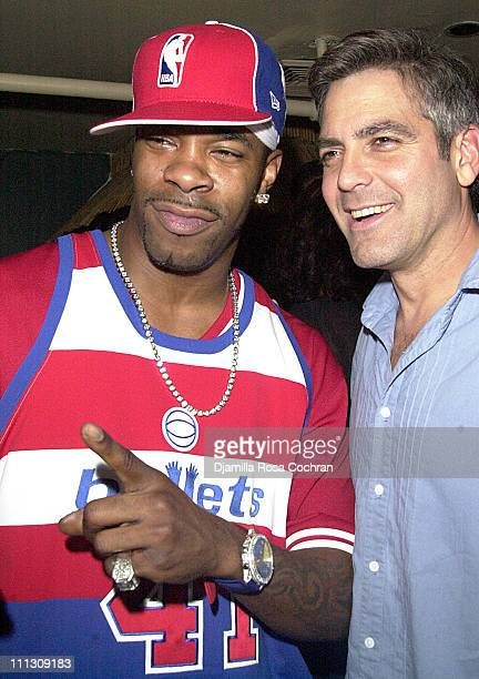 Busta Rhymes and George Clooney during Busta Rhymes Presented with $5000 Bottle of Courvoisier at Float in New York City New York United States