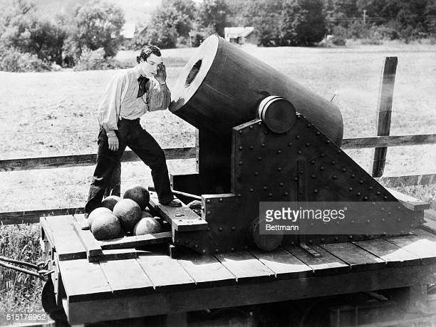 Buster Keaton standing in front of cannon in a scene from 'The General' Undated movie still BPA2# 4626