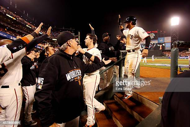 Buster Posey and Gregor Blanco of the San Francisco Giants celebrate after scoring in the sixth inning against the Kansas City Royals during Game...
