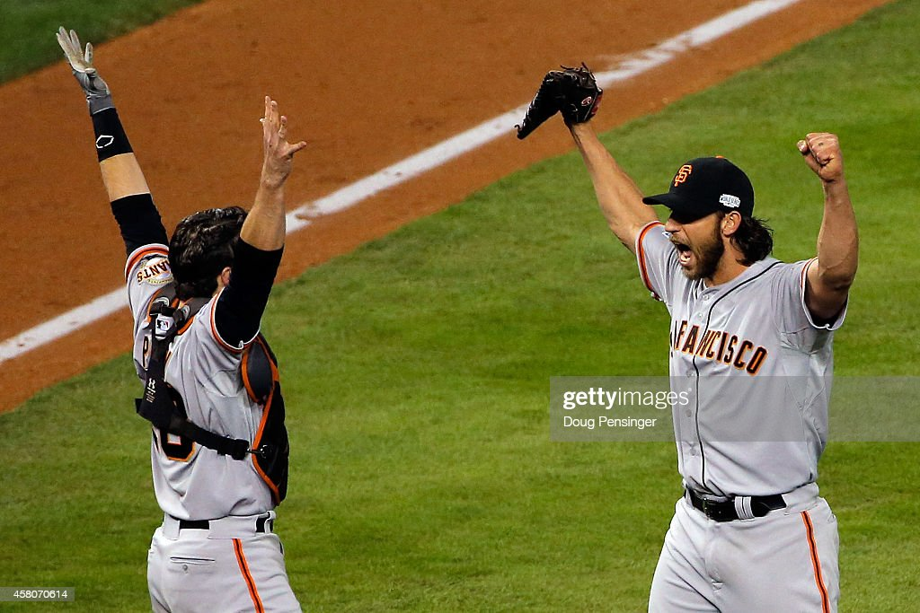 <a gi-track='captionPersonalityLinkClicked' href=/galleries/search?phrase=Buster+Posey&family=editorial&specificpeople=4896435 ng-click='$event.stopPropagation()'>Buster Posey</a> #28 and <a gi-track='captionPersonalityLinkClicked' href=/galleries/search?phrase=Madison+Bumgarner&family=editorial&specificpeople=5974095 ng-click='$event.stopPropagation()'>Madison Bumgarner</a> #40 of the San Francisco Giants celebrate after defeating the Kansas City Royals to win Game Seven of the 2014 World Series by a score of 3-2 at Kauffman Stadium on October 29, 2014 in Kansas City, Missouri.