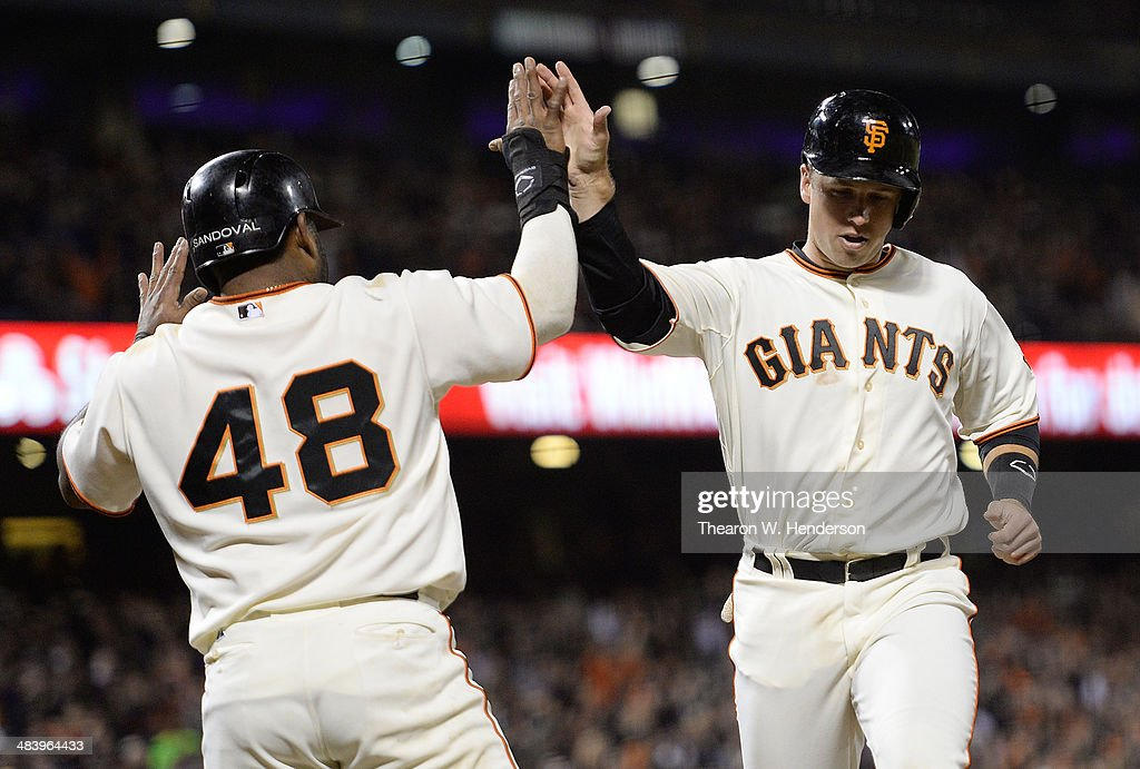 Buster Posey #28 and Pablo Sandoval #48 of the San Francisco Giants celebrate after they both scored on an two-run double from Michael Morse #38 (not pictured) against the Arizona Diamondbacks in the bottom of the fifth inning at AT&T Park on April 10, 2014 in San Francisco, California.