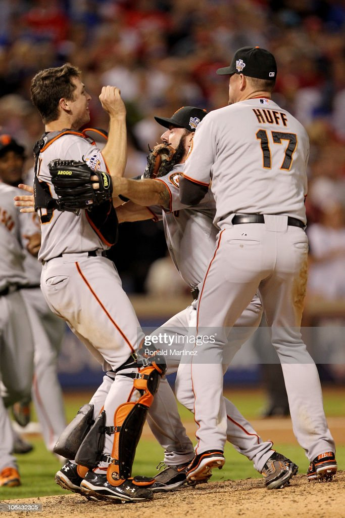 <a gi-track='captionPersonalityLinkClicked' href=/galleries/search?phrase=Buster+Posey&family=editorial&specificpeople=4896435 ng-click='$event.stopPropagation()'>Buster Posey</a> #28, Brian Wilson #38 and <a gi-track='captionPersonalityLinkClicked' href=/galleries/search?phrase=Aubrey+Huff&family=editorial&specificpeople=208964 ng-click='$event.stopPropagation()'>Aubrey Huff</a> #17 of the San Francisco Giants celebrate after the Giants won 3-1 against the Texas Rangers in Game Five of the 2010 MLB World Series at Rangers Ballpark in Arlington on November 1, 2010 in Arlington, Texas.