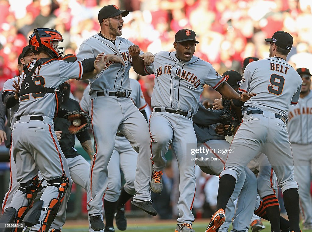Buster Posey George Kontos Santiago Casilla and Brandon Belt of the San Francisco Giants celebrate a win against the Cincinnati Reds in Game Five of...