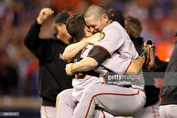 Buster Posey hugs Aubrey Huff of the San Francisco Giants celebrate their 31 victory to win the World Series over the Texas Rangers in Game Five of...