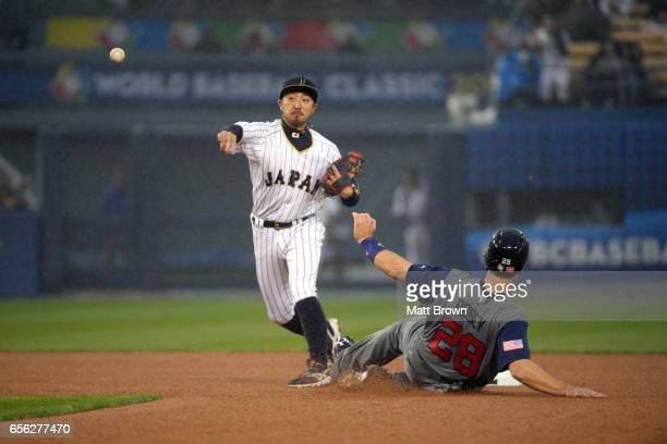 Buster Posey of Team USA is safe at second as Ryosuke Kikuchi of Team Japan throws to first in the top of the third inning of Game 2 of the...