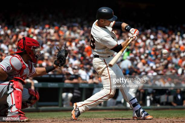 Buster Posey of the San Francisco Giants at bat against the Philadelphia Phillies during the fourth inning at ATT Park on August 20 2017 in San...