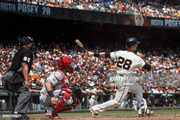 Buster Posey of the San Francisco Giants at bat against the Philadelphia Phillies during the second inning at ATT Park on August 20 2017 in San...