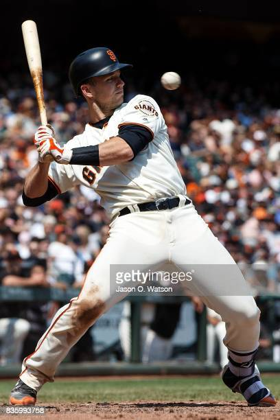 Buster Posey of the San Francisco Giants avoids an inside pitch from Ben Lively of the Philadelphia Phillies during the fourth inning at ATT Park on...